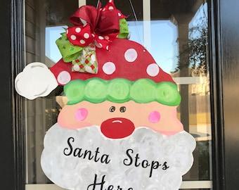Santa stops here wooden door hanger