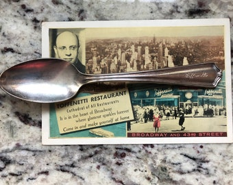 Toffenetti restaurant of Times Square NYC or New York City New York Art deco era restaurant ware spoon with vintage postcard circa 1940's