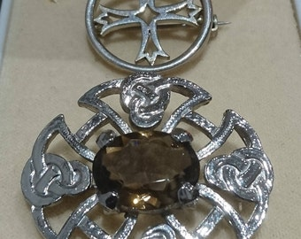 Pair of vintage celtic design brooches
