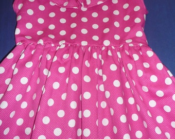 Polka dotted dress with ruffle at the neck.