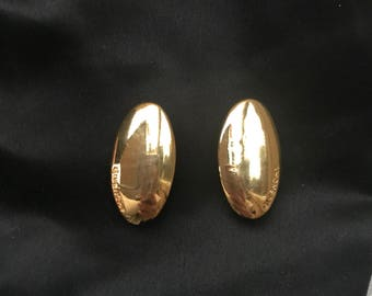 Givenchy gold tone clip on earrings