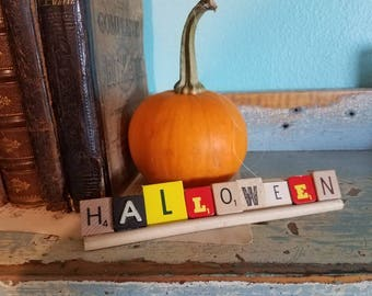 Halloween spelled with vintage game letters repurposed game pieces