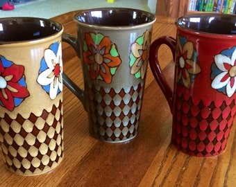 Colorful tall coffee or tea mugs