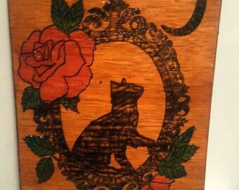 cat in a picture frame