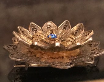 Filigree brooch with a blue stone