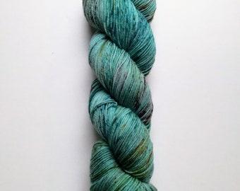 Labradorite: hand dyed tonal and speckled Merino sock yarn by Star Fiber Studio