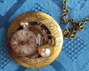 Small gold tone locket pendant steam punk re-cycled up-cycled  old watch vintage