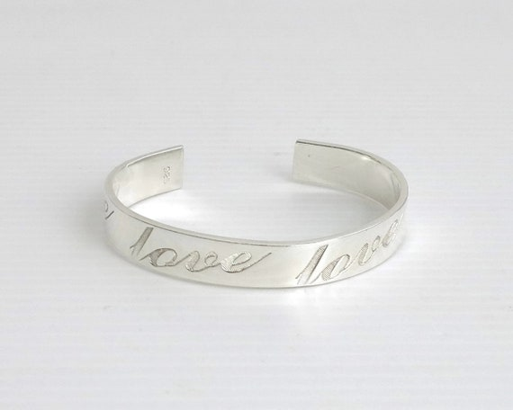 """Sterling silver cuff bracelet with """"love"""" engraved 4 times in large script, open back, 24 grams"""