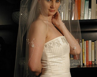"This veil is 34"" long and 72"" wide. Hand beaded flowers and beaded scallop edge."