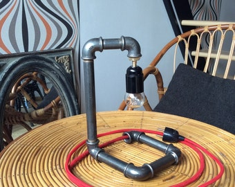 Industrial lamp made with black cast iron fittings