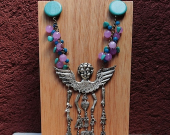 Mexican Milagro necklace with silver colored Milagros with amethyst, turquoise and quartz beads