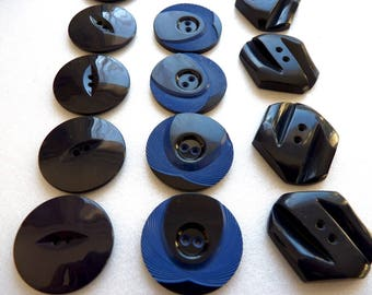 Different sets of 4 or 7 large vintage plastic blue 35 mm diameter, 2 hole buttons.