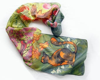 Silk scarf hand painted 63 x 11 in / ginger cat looking at red robin and spring flowers / green, orange and pink