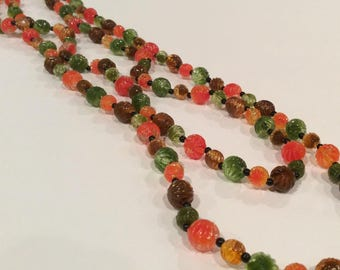 Vintage Single Strand Brown, Orange, and Green Plastic Beads with tiny Black Beads Necklace, Ornate plastic beads, Multi Color, 1960s
