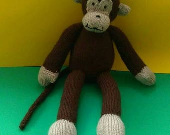 Monkey hand knitted toy