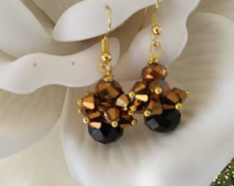 Cluster gold cones on a faceted black crystal bead with fabulous sparkle!