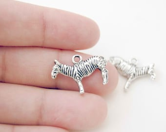 2pcs. zebra horse charm pendant