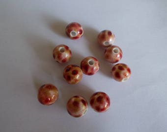 1 set of 10 beads in shades white, red and gold acrylic