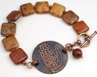 Etched copper palmistry diagram bracelet, palm reader jewelry, metal etching, rust red fossilized coral beads, 7 3/4 inches long