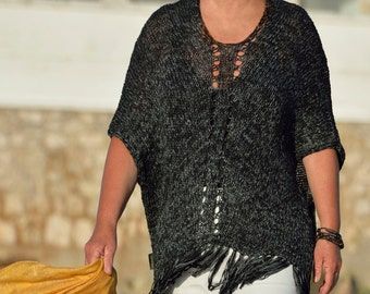 Black Ponchopullover with fringe and hole pattern, hand knitted