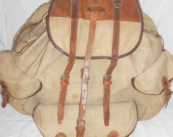 A military backpack made of tarpaulin and leatherAntiques Antiques