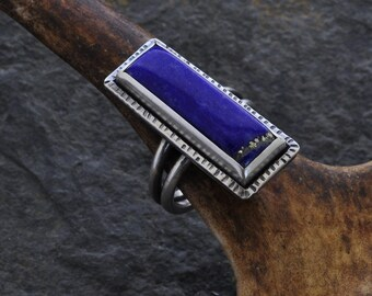 Sterling silver ring set with a Lapis lazuli cabochon