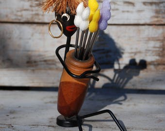 Picker for small items served at the buffet, from the 50s, with a figure that is supposed to represent an African woman