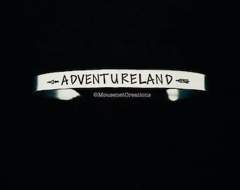 Adventureland, Magic Kingdom, EPCOT, Hollywood Studios, Animal Kingdom, Main Street USA, Fantasyland, Frontierland, Liberty Square, Bracelet