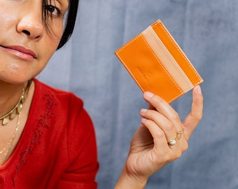 Slim card wallet, made with orange leather. Made In USA with Italian leather