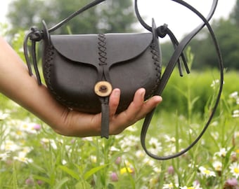 black leather bag. the wren in black vegetable tanned leather. wood button
