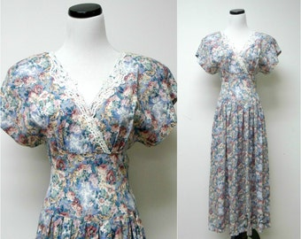 TARAZZIA . vintage floral long torso dress . size 11/12 . fits a small to medium . made in USA
