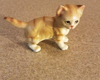 Miniture cat figurine tan stripped eith painted face and whiskers