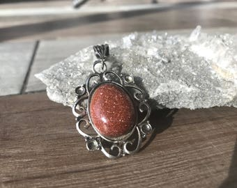 Dazzling Goldstone Pendant