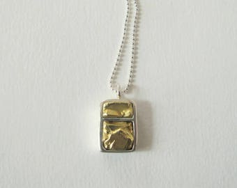 handmade brass and sterling silver pendant