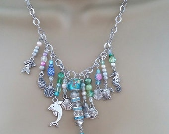 Ocean inspired fantasy. Sea life necklace. Mermaid, fish, shells, seahorse, turtle, dolphin.