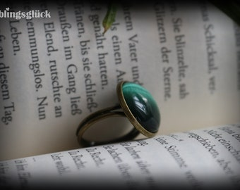 Bronze ring with green cat eye