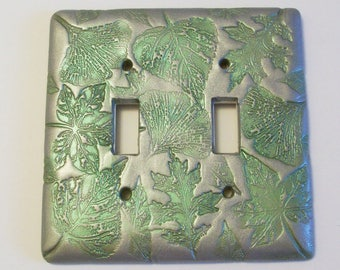 Double toggle light switch cover Collage of leaves in silver and metallic green