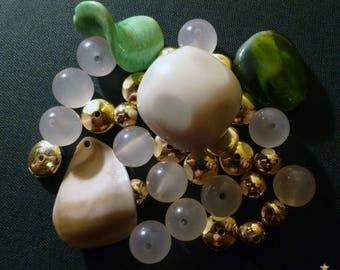 Resin beads green, white, Golden of various shapes, set of 34 pieces
