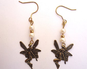 Fairy earrings in antique copper with pearls and gold Miyuki beads in center . Handmade