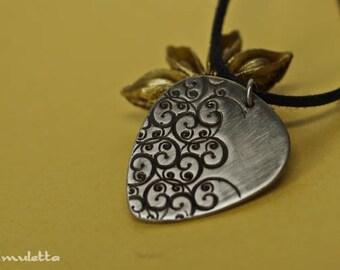 Curlicue nickel silver guitar pick jewelry