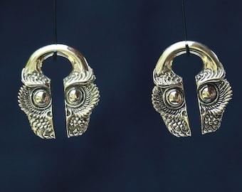 Brass ear weights, owl