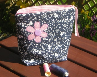 Zippy bag, so many uses. For on-the-go craft projects. For hairbrush & clips. Navy squirrel print, pink daisy applique. Lined.