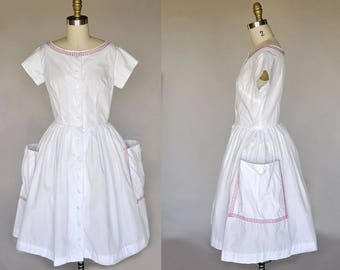 50s white dress | vintage 50s cotton dress with red stitching | oversized pockets, buttons, full skirt
