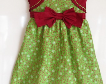 CHRISTMAS Candy Cane Girl's Dress for the holiday season. Simply cute with sewn in Cardigan and bow.