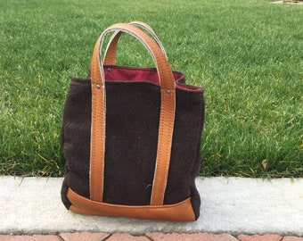 Small, lined leather and wool handbag