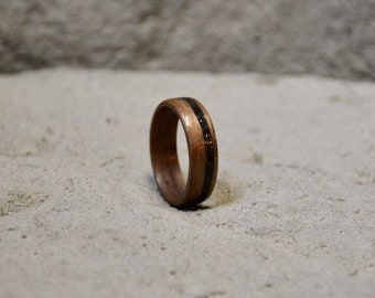Walnut wood ring // walnut bentwood ring with crushed black lava rock inlay