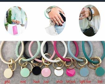 Leather cord bracelet bag attachment