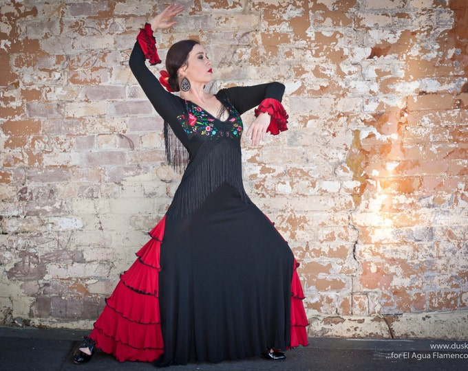 Black BLANCA Flamenco dress with embroidered bodice, fringe and deep red frills.