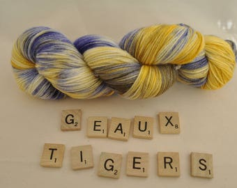 "Hand-dyed yarn, ""Geaux Tigers"" variegated, soft and squishy yarn. Great for socks or shawls. 80/20 Superwash wool/Nylon"