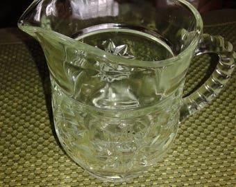 Pressed glass juice or milk jug